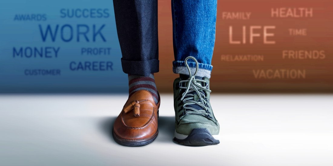 Work Life Balance Concept. Low Section of a Man Standing with Ha
